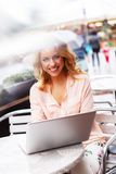 Young woman with laptop outdoors Royalty Free Stock Photos