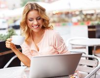 Young woman with laptop outdoors Stock Photography