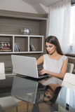 Young woman with laptop in the room Stock Image