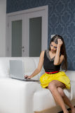 Young woman with laptop in the room. Pretty young woman with laptop in the room Royalty Free Stock Image