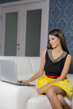 Young woman with laptop in the room. Pretty young woman with laptop in the room Royalty Free Stock Photography
