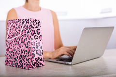 Woman shopping online. Young woman with a laptop shopping online Royalty Free Stock Photography
