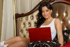Young woman with laptop. Royalty Free Stock Image