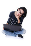 A young woman with a laptop sitting Royalty Free Stock Photography