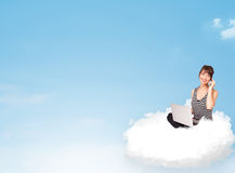 Young woman with laptop sitting on cloud with copy space Royalty Free Stock Image