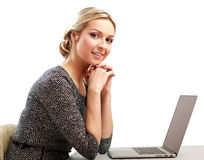 Young woman with a laptop sitting Royalty Free Stock Photos