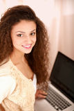 Young woman with a laptop sitting isolated on Royalty Free Stock Images