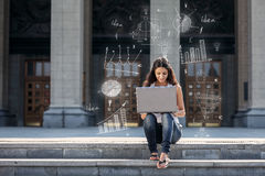 Young woman with laptop sitting on the stairs, near university Stock Photos