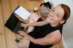 Young woman with laptop smilin stock photo