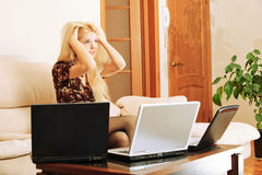 Young woman with laptops Stock Photography