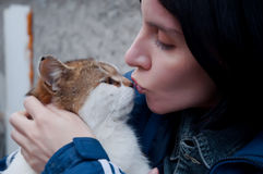 Young woman and a large cat Royalty Free Stock Image