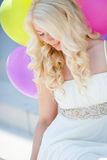 A young woman with large colourful latex balloons Stock Photos