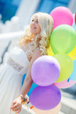 A young woman with large colourful latex balloons Royalty Free Stock Photo
