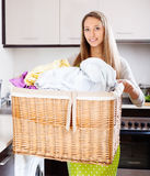Young woman with large linen basket Royalty Free Stock Images