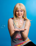 Young woman with a large soap bubble Stock Images