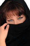 Young woman latent by a black veil Royalty Free Stock Photos