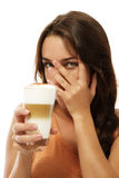 Young woman with latte macchiato coffee hiding her Royalty Free Stock Photos