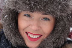 Young woman laughing. Beautiful young woman laughing on snow Royalty Free Stock Photo
