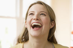 Young Woman Laughing royalty free stock images