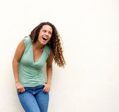 Young woman laughing against white background Stock Images