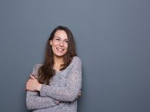 Young woman laughing with arms crossed Stock Photos