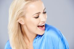 Young woman laughing as she looks down Stock Image