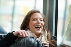 Young Woman Laughing In Bus Royalty Free Stock Photo