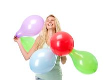 Young woman laughing with colorful balloons Royalty Free Stock Photos