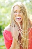 Young woman laughing enjoying summer days. Closeup of beautiful young woman laughing enjoying summer days royalty free stock photos