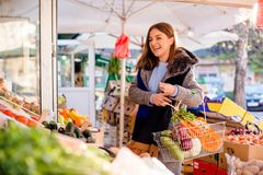 Young woman laughing at farmer`s market Royalty Free Stock Images