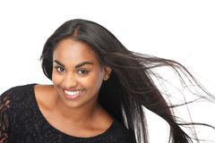 Young woman laughing with hair blowing Stock Images