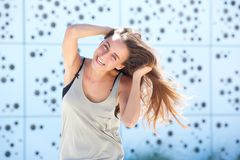 Young woman laughing with hand in hair Royalty Free Stock Image