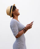 Young woman laughing and holding mobile phone Stock Image