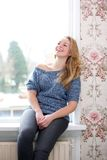 Young woman laughing at home Stock Photo