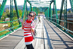 Young woman laughing joyful on bridge Stock Photography