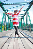 Young woman laughing joyful on bridge Stock Image
