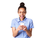 Young woman laughing with mobile phone Stock Photo