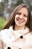 Young woman laughing outdoors Stock Photography