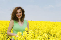 Young woman laughing in the rape flower field Royalty Free Stock Photography