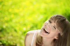 Young woman laughing on spring meadow Stock Photo