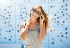 Young woman laughing with sunglasses Stock Photography