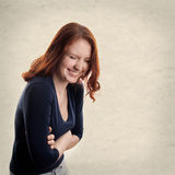 Young woman laughing. With textured background with copy space Royalty Free Stock Image