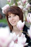 Young woman laughing under a tree in the garden Stock Photography