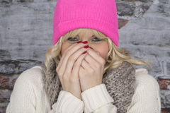 Young Woman Laughing Wearing a Pink Hat Stock Image