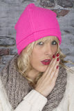 Young Woman Laughing Wearing a Pink Hat Stock Photography