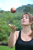 Young woman launching an apple Royalty Free Stock Images