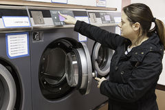 Young woman in a laundry Stock Photo