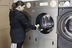 Young woman in a laundry Stock Images