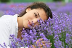 Young woman is in the lavender field, beautiful portrait, face closeup, summer landscape with red poppy flowers Stock Photos