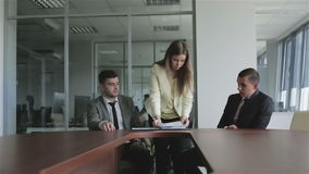 Young woman lawyer putting the signed documents in a black folder. stock video footage